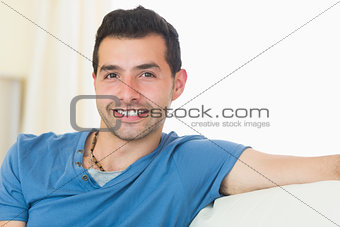 Casual good looking man relaxing on couch