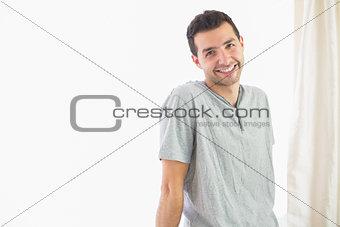 Casual cheerful man looking at camera