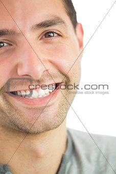 Casual smiling man looking at camera