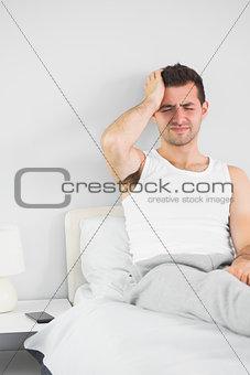 Grimacing handsome man having a headache