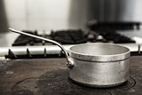 Chrome pot standing on hotplate