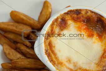 Close up of lasagna and potatoes