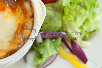 Close up of lasagna and salad