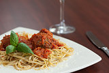 Close up of spaghetti and meatballs with red wine