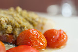 Close up of delicious fish dish with tomatoes