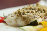 Close up of delicious fish dish with pesto