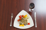 Overhead view of delicious fish dish with red wine