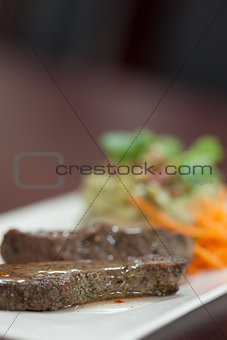 Close up of meat garnished with salad