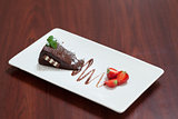 Front view of chocolate cake with strawberries