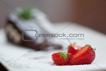 Close up of strawberries with chocolate cake