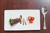Overhead view of chocolate cake with strawberries