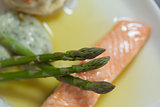 Overhead close up of salmon dish with asparagus