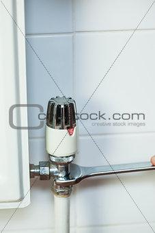 Close up of handyman repairing radiator