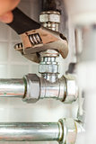 Close up of hand checking pipes