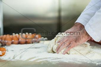 Close up of baker preparing dough