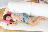 Lovely casual woman napping on her couch