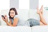 Content young woman lying on her couch at home