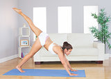 Slim woman stretching her body in yoga pose