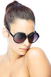 Pretty woman wearing gigantic round sunglasses