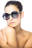 Beautiful brunette woman with gigantic round sunglasses