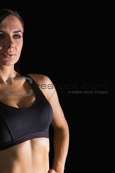 Attractive brunette woman wearing sportswear posing