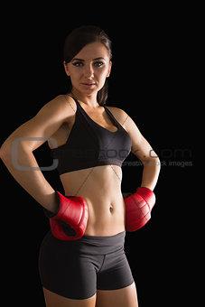 Beautiful sporty woman posing wearing boxing gloves