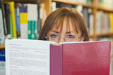 Mature female student reading a book