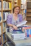 Content calm female librarian returning books
