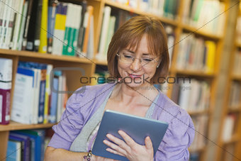 Content mature librarian using her tablet