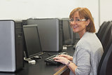 Smiling female mature student using a computer