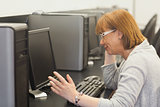 Annoyed mature student working on computer
