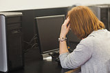 Annoyed female mature student working on computer