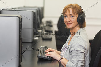 Portrait of female mature student working on computer