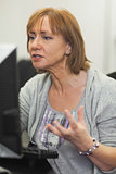 Irritated mature woman working on computer