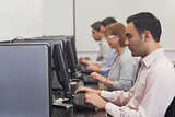 Mature students sitting in computer class