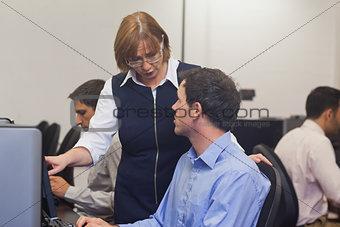 Mature female teacher talking to a student
