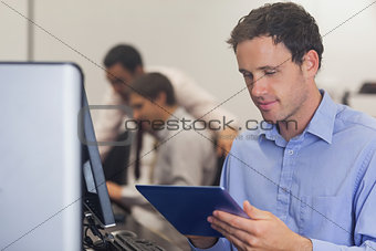 Male mature student working with a tablet