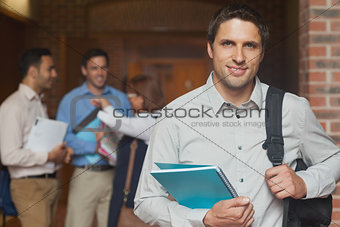 Attractive casual mature student posing in corridor