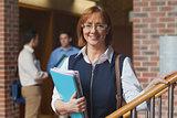 Mature female student posing in corridor