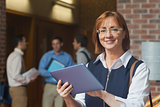 Portrait of cute mature student holding her tablet