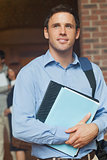 Handsome male mature student posing holding some files
