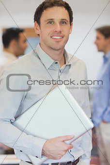 Attractive male mature student posing in classroom