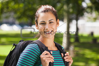 Casual smiling student looking at camera