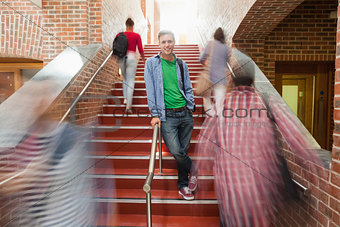 Casual handsome student standing on stairs