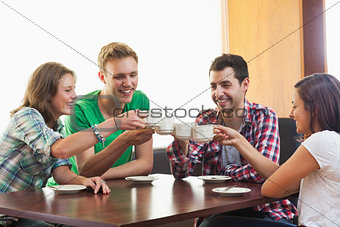 Four casual students drinking a cup of coffee