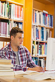 Handsome concentrating student using computer