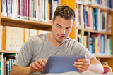 Attractive casual student using tablet