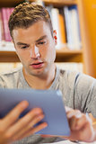 Attractive focused student using tablet