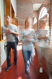 Students walking through hallway toward camera