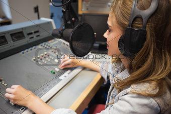 Focused pretty radio host moderating